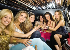 Group of beautiful women clinking glasses with champagne inside
